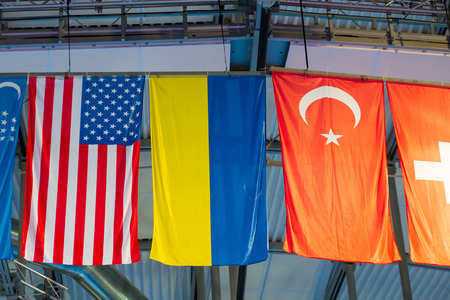 International flags on the  arena. Flags of different countries at sports competitions Imagens