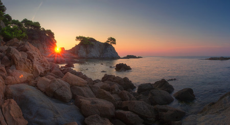 Panoramic landscape of beach at sunrise in Lloret de Mar, Spain coast. Costa Brava sea nature in morning sunshine Stok Fotoğraf