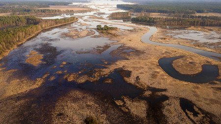 Aerial view of flood on floodplain. Spring river view from above Imagens