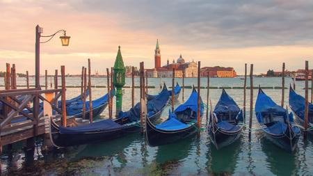 Beautiful Venice landscape at sunset. Venice gondolas on San Marco square, Grand Canal, Venice, Italy