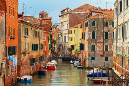 Venice street cityscape, Italy. Old Venice town with boats in water canal.