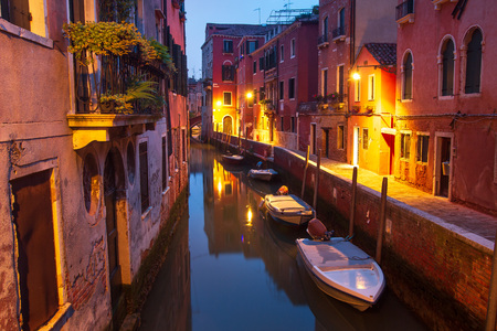 Venice at night. Boats in canal street houses in water. Venice night cityscape, Italy