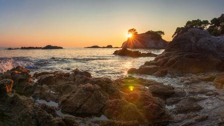 Panorama Costa Brava sea beach at the morning sunrise. Sea nature landscape rocky coast in Lloret de Mar