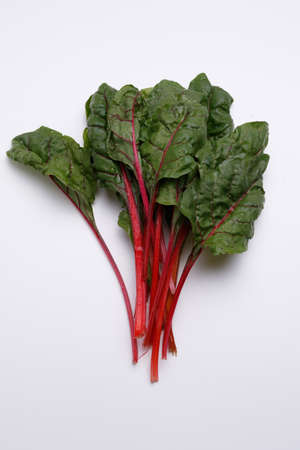beetroot leaves close up on white background
