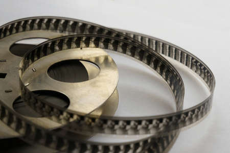 Film strip and iron cassette on a white background. Close-up
