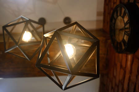 Electric lamp in the shape of a geometric shape. Close-up