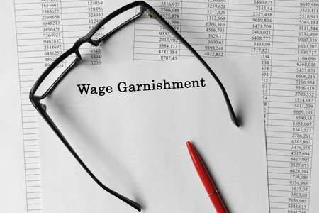 Paper with Wage Garnishment on a table. Business concept Stock Photo