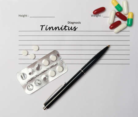 Tinnitus diagnosis written on a white piece of paper. Medical concept