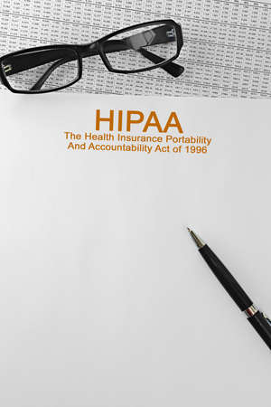 Paper with HIPAA The Health Insurance Portability and Accountability Act of 1996 on a table. Business concept Foto de archivo