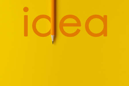 The interactive composition of the orange pencil photo replaces the orange words of creative thinking used for presentations in the field of education, business or creativity. Lighting on a pencil in the studio Banco de Imagens