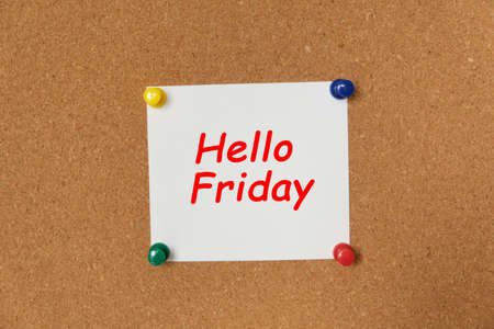 Text Hello Friday written on a sticker pinned on a cork board Stock Photo
