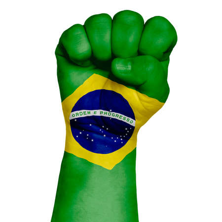 A discreet image of a fist painted in the colors of the flag of Brazil. Image on a white background. Isolate