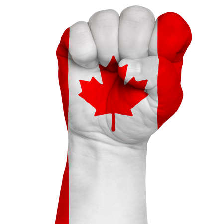 Restrained image of a fist painted in colors of the flag of Canada. Image on a white background. Isolate Stock Photo