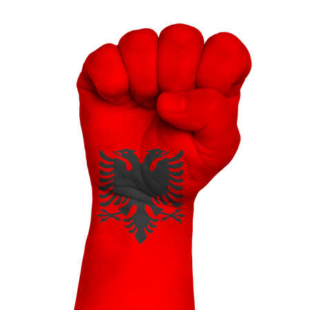 Flag Of Albania on hand with clenched fist gesture over white background.