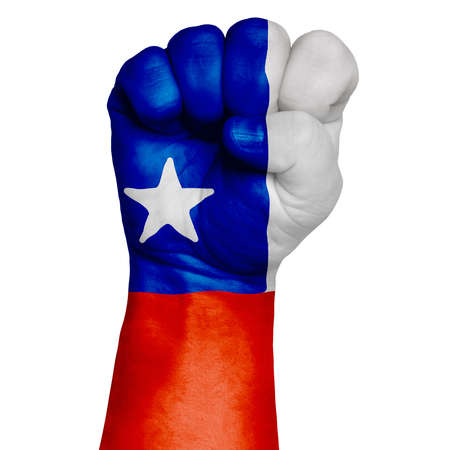 Restrained image of a fist painted in the colors of the flag of Chile. Image on a white background. Isolate