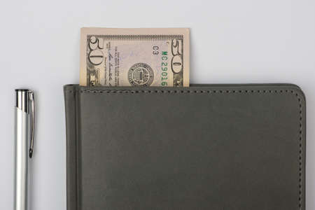 Business notebook and pen with US dollars. Business concept Archivio Fotografico