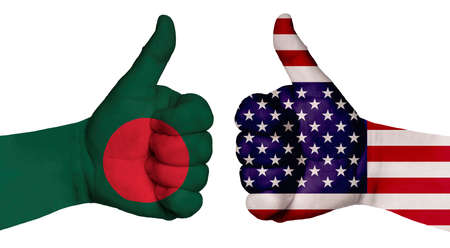 The concept of strengthening the relationship of nations. Two hands are painted with flags of different countries, with a thumb raised up. Bangladesh and the USA Banco de Imagens