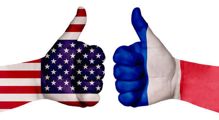 The concept of strengthening the relationship of nations. Two hands are painted with flags of different countries, with a thumb raised up. France and the USA Stock fotó