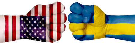 The concept of the struggle of peoples. Two hands are clenched into fists and are located opposite each other. Hands painted in the colors of the flags of the countries. Sweden vs USA