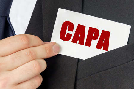 Business concept. Businessman holds a card with the text - CAPA Stok Fotoğraf