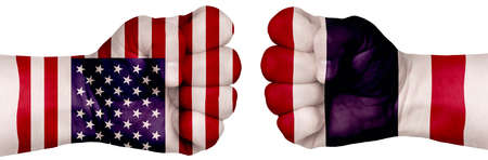 The concept of the struggle of peoples. Two hands are clenched into fists and are located opposite each other. Hands painted in the colors of the flags of the countries. Thailand vs USA