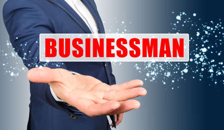 Finance and business concept. A businessman holds his hand, palm up, above the palm the inscription - BUSINESSMAN