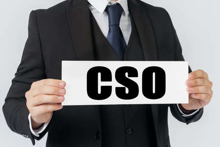 Business and finance concept. A businessman holds a sign in his hands which says CSO -CHIEF STRATEGY OFFICER Stockfoto