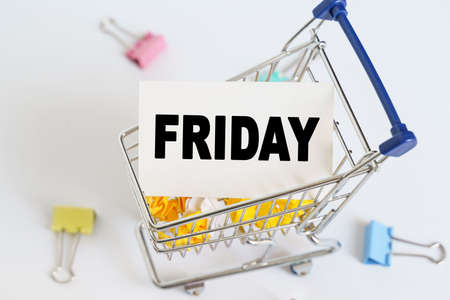 Business concept. In the shopping cart, the text is written on the card - FRIDAY. Stock fotó