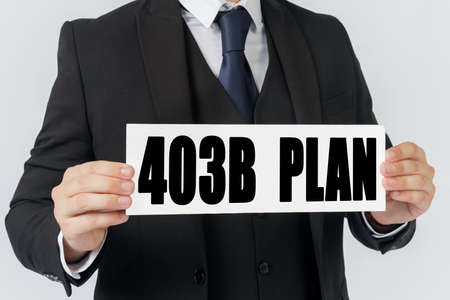 Business and finance concept. A businessman holds a sign in his hands which says 403B PLAN