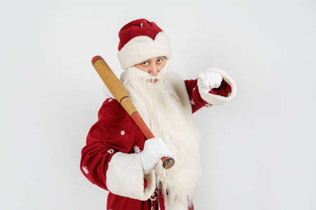 Holidays and christmas concept. Santa Claus with a baseball bat in his hands. Isolated on white Stock Photo