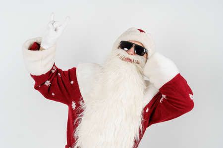 Christmas and New Years concept. Santa Claus shows a gesture by raising up two fingers. Isolated background. Stock Photo