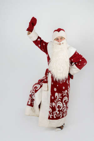 Holidays and christmas concept. Santa Claus is dancing. Isolated on white