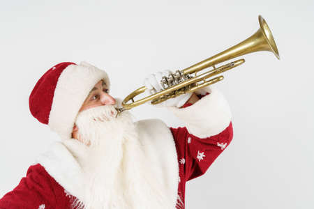 New Year and Christmas concept. Santa Claus plays the pipe. Isolated background