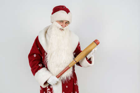 Holidays and christmas concept. Santa Claus with a baseball bat in his hands. Isolated on white Foto de archivo