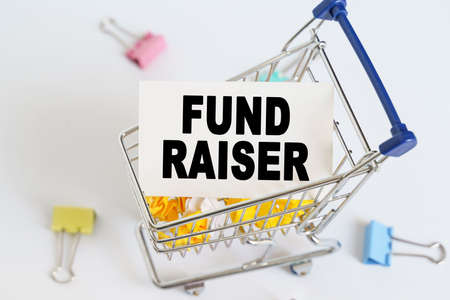 Business concept. In the shopping cart, the text is written on the card - FUND RAISER.