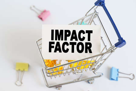 Business concept. In the shopping cart, the text is written on the card - IMPACT FACTOR.