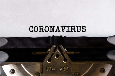 Vintage typewriter with printed text - CORONAVIRUS, on a sheet of paper