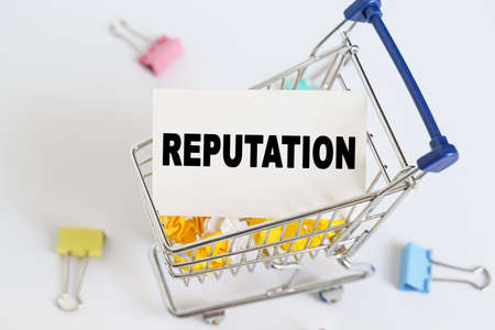 Business concept. In the shopping cart, the text is written on the card - REPUTATION. Stock fotó