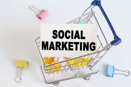 Business concept. In the shopping cart, the text is written on the card - SOCIAL MARKETING.