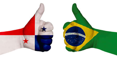 Politics and finance concept. Two hands with a raised finger. They portray the gesture class, managed to negotiate. On the hands of the image of the flags of the countries, Brazil and Panama