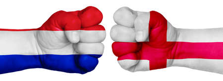 The concept of the struggle of peoples. Two hands are clenched into fists and are located opposite each other. Hands painted in the colors of the flags of the countries. France vs England