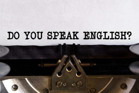 Vintage typewriter with printed text - DO YOU SPEAK ENGLISH