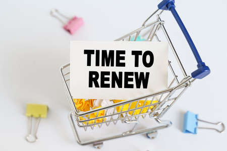 Business concept. In the shopping cart, the text is written on the card - TIME TO RENEW.