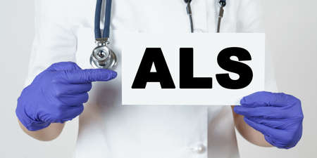 Medicine and health concept. The doctor points his finger at a sign that says - ALS. amyotrophic lateral sclerosis Stock fotó