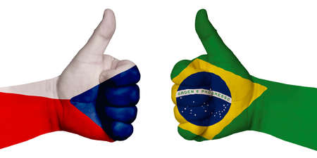 Politics and finance concept. Two hands with a raised finger. They portray the gesture class, managed to negotiate. On the hands of the image of the flags of the countries, Brazil and Czech Republic