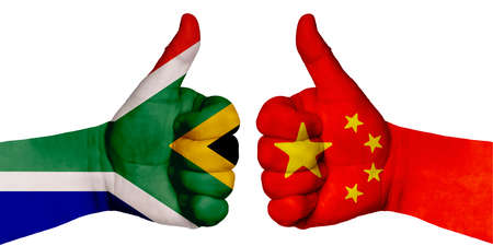 Politics and finance concept. Two hands with a raised finger. They portray the gesture class, managed to negotiate. On the hands of the image of the flags of countries, China and South Africa