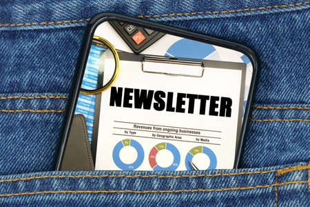 Business and finance concept. In a pocket of jeans there is a smartphone on the screen of which the text - NEWSLETTER
