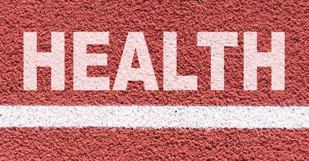 Health and sport concept. It says on the treadmill along the white line - HEALTH Archivio Fotografico