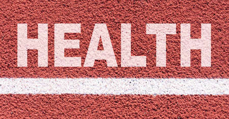 Health and sport concept. It says on the treadmill along the white line - HEALTH