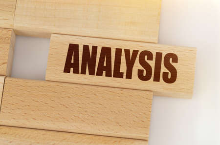 Business and finance concept. There is a wooden on the table, on one it is written - ANALYSIS 免版税图像